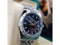 New Silver Rolex DateJust with Black Dial and Markers Comes Rolex Bagged and Boxed with Paperwork