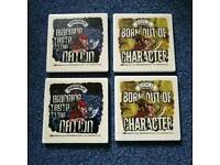 Four ceramic Wychwood Brewery coasters