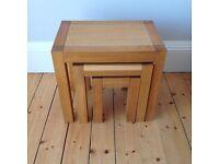 Nest of solid oak side tables