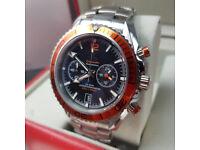 Rossco's Watches. Omega Seamaster Professional. Silver Bracelet, Black Face with Orange Bezel.