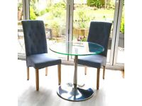 Glass dining table and 2 chairs for sale for only £20