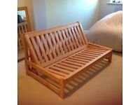 'Futon Company' Futon in excellent condition. Double bed size, oak frame with covered mattress.