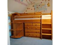 A great sleeper wooden storage bed with kids sleep station, desk, storage & book shelf.