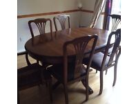 DARK PINE EXTENDING OVAL DINING TABLE WITH 4 CHAIRS & 2 CARVERS