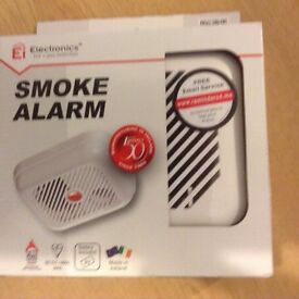 Brand New Smoke Alarm with battery included still in box