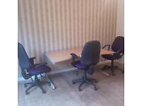 Office desk and 3 purple swivel chairs