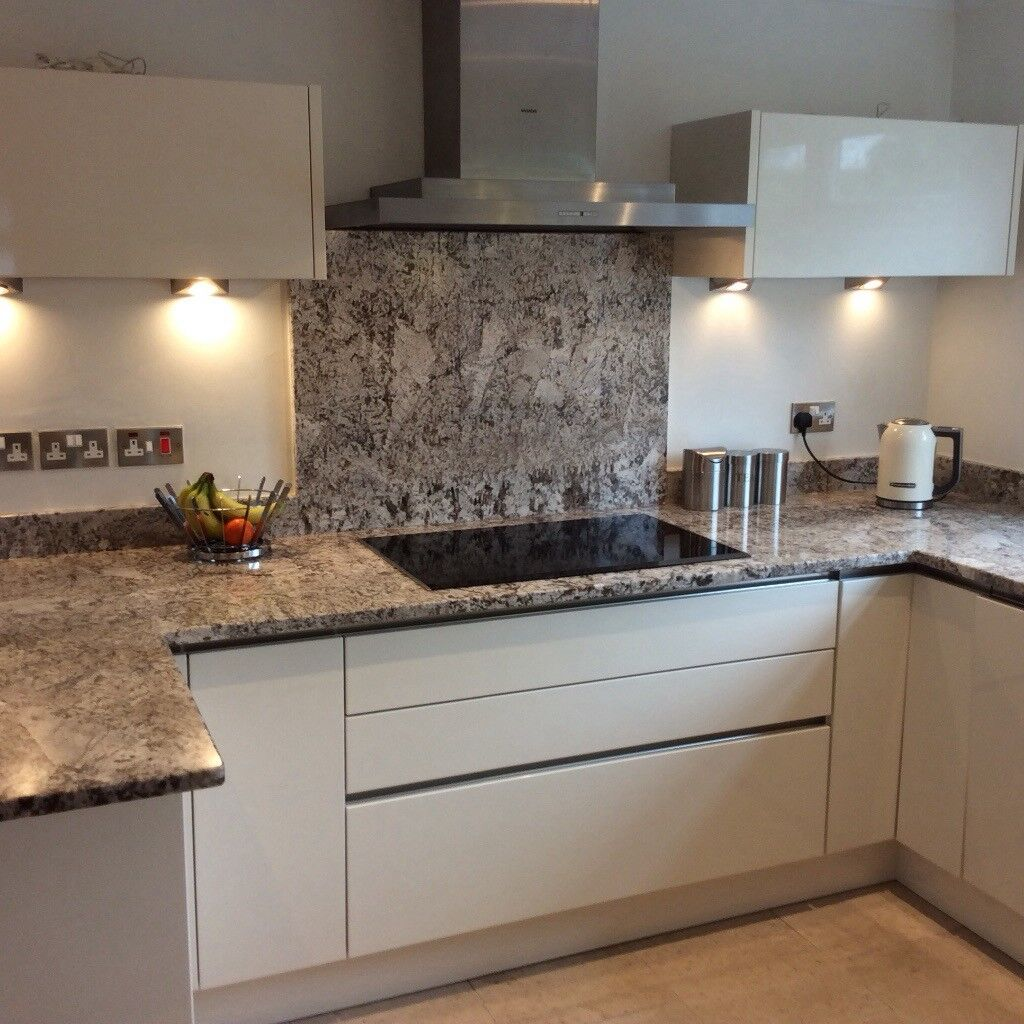 Fitted German Kitchen, Granite Worktops And All Appliances. Pale Cream  Gloss Handle Less Finish