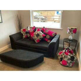Black sofa bed and foot stool
