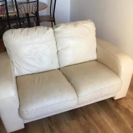 2x 2 Seater Cream Faux Leather Sofas