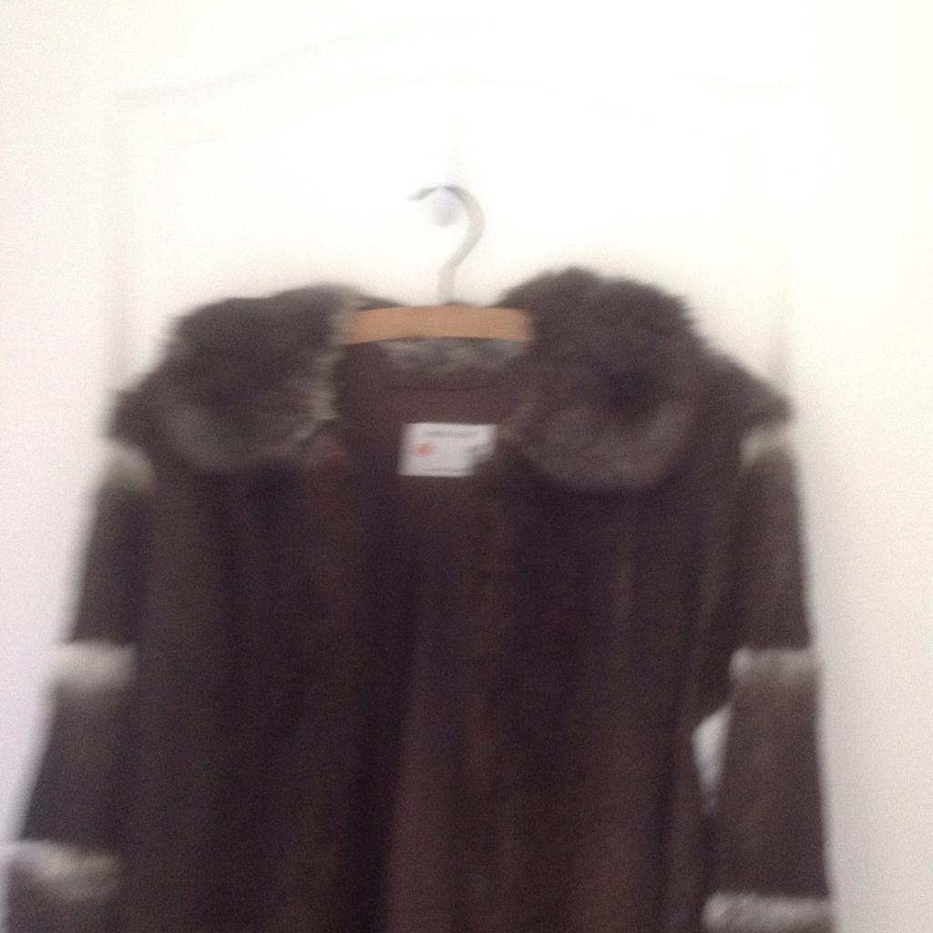 Beautiful calf length Fur coat