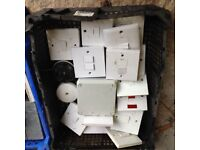 Various used plug sockets, light switches and fuse boxes