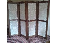 Bedroom screen, four panelled wood with material inlays.
