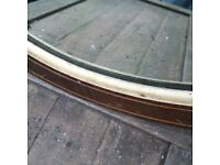 beautiful old vintage mirror with wooden frame and a bit of patina