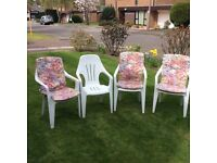 8 garden chairs complete with seat covers.