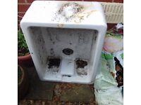 Old white ceramic sink