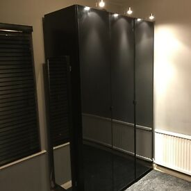 Ikea PAX Wardrobes in black with black glass doors and light fittings. 2 doubles and 3 singles.