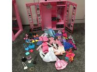 Barbie bundle with lots of accessories , house, furniture, Barbies, clothes, wardrobe and more .