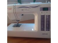 Newhome sewing machine. Complete with everything that came with it. As new.