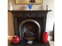 Gorgeous black and silver cast iron fire surround with gas fire and marble harth .