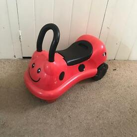 Ladybird sit on scooter