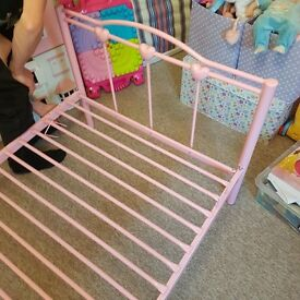 Girls pink bed and baby cot