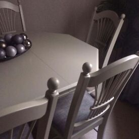 Dining room table painted in farrow and ball 'light grey' with 6 newly upholstered chairs