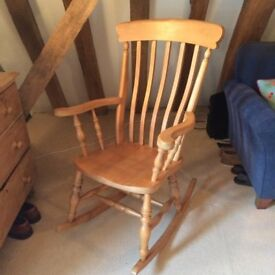 Slat back wooden rocking chair.