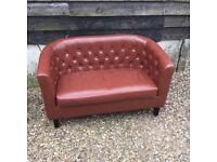 Tan faux leather sofa