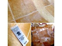 Beautiful unused Leather Rug with animal print (140x180cm)