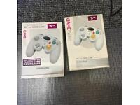 2 Control pads for GameCube and Wii. One still sealed in box, other one unused.