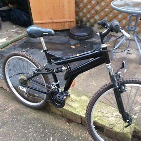 "Mountain Bike, 15 gears, 26"" wheels, hardly been used."