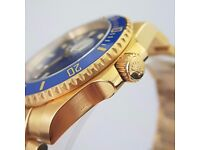 New gold Blue faced Rolex Submariner with blue Ceramic Bezel and all gold oyster bracelet