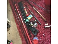 A mix of fishing gear. Rods reels floats