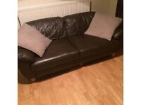 Pair of small brown leather sofas