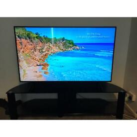 """55"""" Samsung 4K uultra had tv and 65"""" black glass tv stand"""