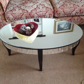 Large mirrored oval coffee table