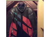 Leather bike suit black and red . Pristine condition