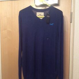 GENUINE NEW Hollister V neck Jumper in Medium Blue. With Tags.