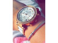Gold and white Michael Kors watch
