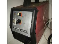 Rockwell Mig welder with gas wire and helmet, ready to use