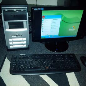 Monitor, PC, Wireless Mouse and Keyboard.