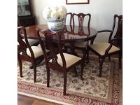 Dining table and 6 chairs (2 carvers) dark mahogany. £200 ono