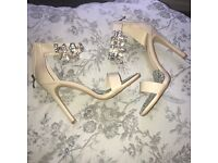 Nude Boohoo heels. U.k. size 4 Worn only once for a hour. No marks or scuffs, basically new.