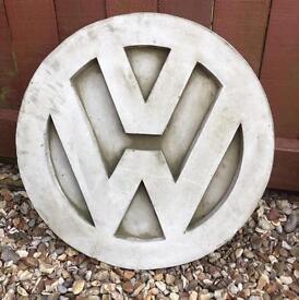 Large stone garden Volkswagen sign plus other Volkswagen items