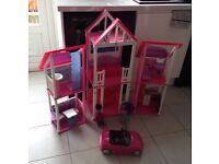 Barbie house ,car and dolls