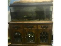 4 ft fish tank and antique cabinet