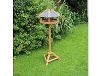 Hexagonal Wooden Bird Table with Slate Effect Roof.