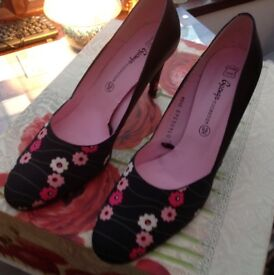 Lovely black and red flowered shoes leather and material uppers. Size 6.5