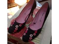 Black and red shoes size 6.5 leather