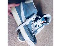 Blue Nike shoes (Size 5)